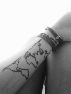 map of the world arm tattoo