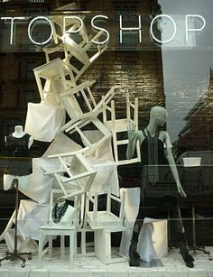 Topshop window display...love the chaos and contrast.