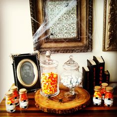 "A ""BOO-tiful"" Candy Buffet by Kate Aspen Vintage Milk Bottle Glass Favor Jar with Cork Stopper by Kate Aspen. Fill with candy corn for Halloween Party Favors."