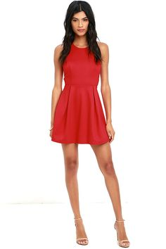 If you're going stir crazy, slip into the Cutout and About Red Skater Dress and head to the city! Medium-weight stretch knit shapes a rounded neckline atop a sleeveless bodice with princess seams for a tailored fit. A sultry racerback is framed by cutouts for a unique open back, all above the fitted waist and flirty skater skirt below. Hidden zipper/hook clasp at back.