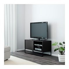 IKEA - HAGGE, TV-benk, svart, , Skyvedører sparer plass og skjuler alle tingene dine i tillegg til at alt er lett tilgjengelig når du trenger det.Innebygget kabelhåndtering; holder kabler ute av syne men lett tilgjengelig.