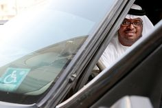 Abu Dhabi, United Arab Emirates, August 25, 2014: Sulaiman Al Ameri, 40, an Emirati #disabled #driver, in his modified vehicle, parked outside his apartment building in the Al Zahiya area area of Abu Dhabi on August 25, 2014. Christopher Pike / The National