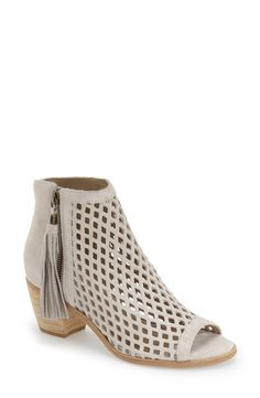 Cool cutouts add a trendy vibe with this suede bootie that is easy to wear all year long.