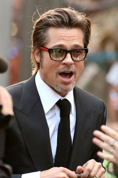 Brad Pitt | black rim glasses