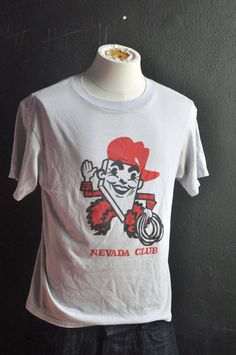 Vintage T shirt Nevada Club Cowboy State Souvenir - perhaps something less like a lithograph and more like an icon based mascot?