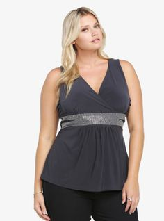 Be the center of attention in this stunning slate grey babydoll top. With a plunging surplice neckline and ruched sides, the smocked waist is decorated with dazzling rhinestones that are certain to get you noticed.