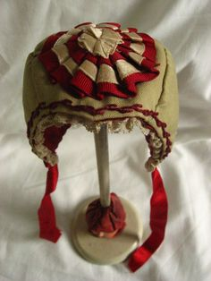 put the rosette on back. the embroidery stitch with the thin ribbon is a nice touch Thin Ribbon, Victorian Hats, Bonnet Hat, Headgear, Doll Accessories, Antique Dolls, Rosettes, Embroidery Stitches, Doll Clothes