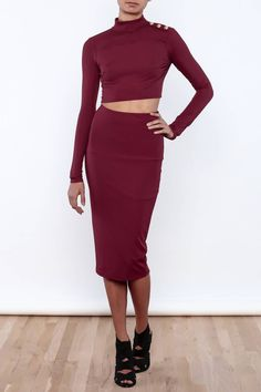 Ribbed matching skirt set with a cropped top and pencil skirt. Cropped top features long sleeves, shoulder button detailing, button back closure and back cut out. Pencil skirt has a midi length hemline.   Long Sleeve Midi Set by BLANC. Clothing - Matching Sets New York City