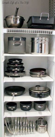 Tips for organizing pots and pans. I love this storage in lieu of low under the countertop storage! What a brilliant idea!