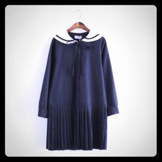 Sailor collar accordion pleated dress in black Adorable sailor dress in a super soft silky rayon. Button up front with an accordion pleated skirt. Shoulder 15 1/2 inches, bust 40 inches & length from shoulder to hem 33 1/2 inches. Multi seasonal wardrobe staple! Moricode Dresses Mini
