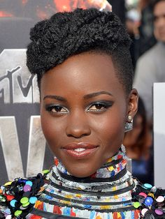 Lupita Nyong'o's MTV Movie Awards Makeup: Exclusive Details on the 'Disco-Inspired' Look! | People.com // amazing drama on the eyes, matte skin and easy lips
