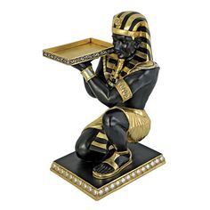 online shopping for Design Toscano Egyptian Pharaoh's Kneeling Nubian Servant Butler Side Table, 3 Feet, Black/Gold from top store. See new offer for Design Toscano Egyptian Pharaoh's Kneeling Nubian Servant Butler Side Table, 3 Feet, Black/Gold Egyptian Furniture, Egyptian Home Decor, Chinese Furniture, Egyptian Pharaohs, Egyptian Art, Egyptian Tattoo, Pedestal Coffee Table, Coffee Tables, Animal Statues