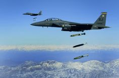 U.S. Air Force F-15E Strike Eagle aircraft from the 335th Fighter Squadron drop 2,000-pound joint direct attack munitions on a cave in eastern Afghanistan on Nov. 26, 2009. The 335th is deployed to Bagram Airfield, Afghanistan, from Seymour Johnson Air Force Base, N.C. DoD photo by Staff Sgt. Michael B. Keller, U.S. Air Force.