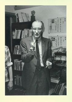 William Burroughs with lighter and cigarette. 1984