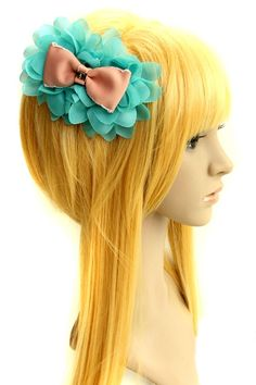 The hair clip barrette crafted in chiffon, featuring flower embellishment to main, bow-knot to center. It makes you sweet and fashion.$21