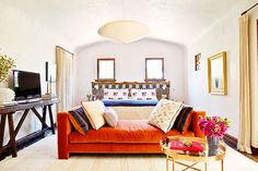 Orange daybed in bedroom lounge area and small coffee table