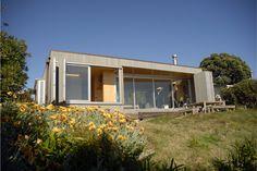 Coromandel Beach HouseBi-fold slatted cedar shutters open to the view