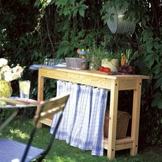 Sweet Paul's Ikea-based outdoor kitchen station. This would be great to set up next to a propane grill.