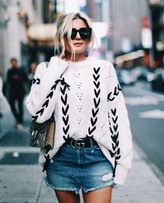 Black + white sweater with denim mini.