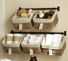 Using a towel rack and baskets to hold odds and ends