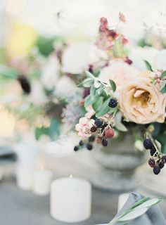 Such pretty berries and roses in this centerpiece. #reception #flowers
