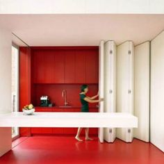 Kitchen With Folding Panel For Space-Saving Functional Solutions- Red And White Kitchen home trends design photos, home design picture at Home Design and Home Interior Contemporary Architecture, Interior Architecture, Kitchen Interior, Kitchen Design, Interior Walls, Murs Mobiles, Red And White Kitchen, Red Kitchen, Kitchen Office