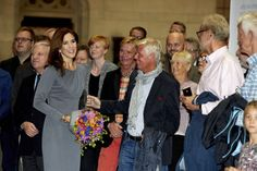 Crown Princess Mary mingles with the Danish gay community as she marks the silver wedding anniversary of registered partnership between persons of the same sex. Here she is saying hello to Sales Director of the Danish travel agency 'Star Tour', Stig Elling.