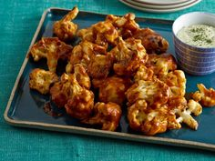 Get Buffalo-Style Cauliflower with Cashew-Dill Dipping Sauce Recipe from Cooking Channel