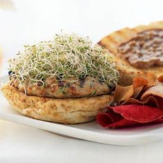 No recipe can offer too much flavor for Assistant Food Editor Ann Taylor Pittman. Her burger is made spicy with Thai chile paste and rounded out with a sweet, creamy Thai-style peanut sauce. Onion sprouts, which look similar to alfalfa sprouts, have a pungent bite. You can find them next to the alfalfa sprouts in many supermarkets.