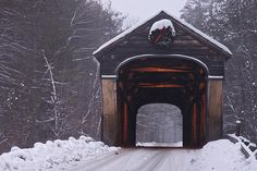 The Corbin Covered Bridge in Newport, New Hampshire, in a light snow storm. It's still wearing it's Christmas decoration. Old Bridges, Old Barns, Covered Bridges, Winter Scenes, Snow Scenes, New Hampshire, Newport, Vermont, Jack Frost