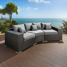 Luxury outdoor garden 3 seater sofa/settee black rattan/grey cushion 17. Truly stunning in design, this large 3 seater sofa gives a super high-class feel. This set consists of left and right hand end pieces, rounded middle sofa piece, clips to hold them together, 3 x scatter cushions and a heavy-duty cover in green. Call 02476 642139 or email sales@quatropi.com or visit www.quatropi.com for additional information.