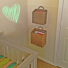 Book storage for nursery or children's room. Wall hanging baskets from World Market. #books #storage #nursery #playroom #children #organization #worldmarket