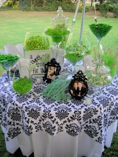 Look how the candy pops on this table! Sometimes simple is better. Having a beautiful linen and keeping your candy to different shades of one color is a great way to do it!