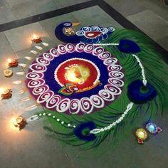 Beautiful peacock rangoli designs for diwali .This rangoli is specially for Diwali. Rangoli Designs Peacock, Indian Rangoli Designs, Rangoli Designs Latest, Simple Rangoli Designs Images, Rangoli Border Designs, Rangoli Patterns, Colorful Rangoli Designs, Rangoli Ideas, Beautiful Rangoli Designs