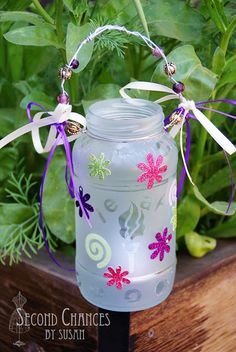 This collection of camp crafts includes cool recycled projects like these jar lanterns and t-shirt tote bags