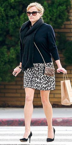 REESE WITHERSPOON Reese is having a serious animal-print moment. We already made the Wild joke, so we'll just talk about why this outfit works: Classic shapes, clean lines, and a few surprising twists – like the double-dose of leopard and that chunky padlock bracelet.