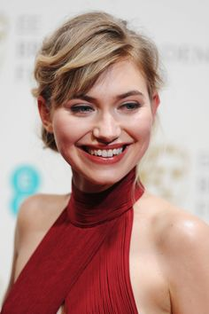 Imogen Poots chose a cinnamon lip color and a loose updo for the BAFTA Awards.