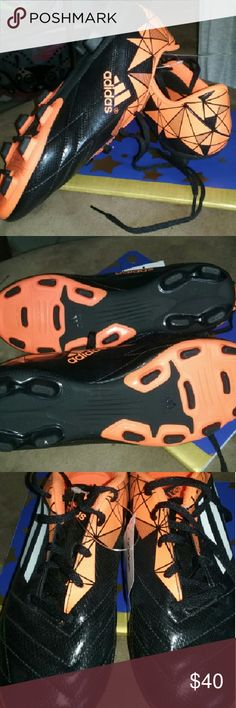 NWT Adidas cleets! Perfect condition! Bought for my daughter for softball and she can't fir in them, lost receipt & she threw away box. Bright orange, black & white Colors. Never worn! Adidas Shoes Athletic Shoes