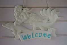 Mermaid and Dolphins Welcome Sign  PICK YOUR by ByTheSeashoreDecor, $32.00. Made of cast iron. Made to last a lifetime and then some.