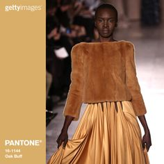 Oak Buff is a mellow, comforting and warming shade that brings good feelings. One of nature's many illustrious shades, the golden-yellow Oak Buff acts to nurture and comfort. Fashion by Getty Images