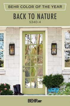 Painted front doors are a classic home decor trend, and we're loving this colorful one featuring the Behr paint 2020 Color of the Year: Back to Nature. This light green hue pairs beautifully with the neutral white trim and light stone siding on the exterior of this home. Click below for more design inspiration.