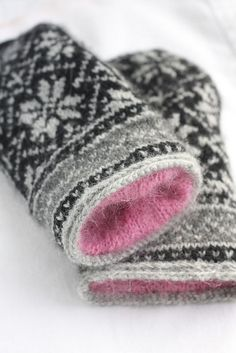 The Northman Mittens created by David Schultz and listed on Ravelry.  Pink kidsilk mohair lines the inside.