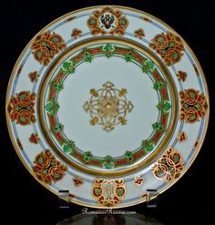 An antique Russian Imperial porcelain plate from the Wedding Banquet service of Grand Duke Constantine (Konstantine) Nikolaevich (son of tsar Nicholas I) and German Princess Alexandra Iosifovna of Saxe-Altenburg. Made at the Imperial Porcelain Factory in St Petersburg in 1848. The service was designed by Feodor Solntsev (1801-1892), - an architect,  painter,  professor of the Saint Petersburg Academy of Arts, archaeologist and an expert in Russian antiquities.