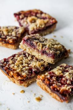 These whole-grain bars make for a fiber-filled breakfast, afternoon snack, or sweet treat that'll curb your entire family's sweet cravings. Feel free to use any variety of fruit preserves you like. For us, the tartness of raspberry preserves complement the nuttiness of tahini best! Raspberry Preserves, Fruit Preserves, Oatmeal Squares, Variety Of Fruits, Oatmeal Recipes, Afternoon Snacks, Dessert Recipes, Desserts, Yummy Snacks