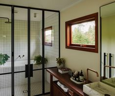 These steel framed shower doors give this bathroom a chic, minimal look. Photography by: Derek Henderson. Steel Frame House, Backyard House, Inside Home, Shower Doors, Shower Bathroom, House Tours, Minimalism, New Homes, House Design