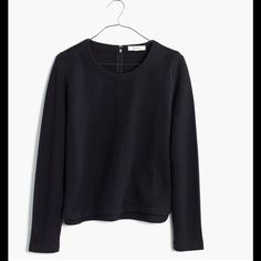 Madewell Jacquard Grid Top in Black A cropped sweatshirt in a soft textural jacquard. With its coolly slanted seams and a curved hem, this top can easily put in an appearance at the office. Price is firm. Madewell Tops