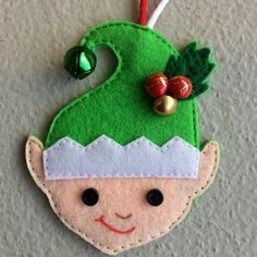 Felt Christmas Tree Felt elf decoration embellished with wee buttons on his hat Felt Christmas Stockings, Christmas Stocking Pattern, Felt Christmas Ornaments, Christmas Sewing, Diy Ornaments, Beaded Ornaments, Glass Ornaments, Christmas Stocking Images, Elf Decorations