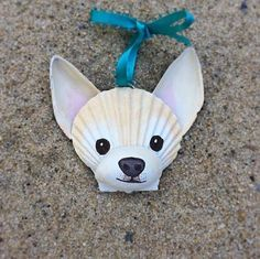 This adorable, carefully hand painted Chihuahua ornament is made entirely of seashells, most of which I collected myself from my favorite Cape Cod beach. The face is a scallop shell, nose a slipper shell and ears are made of mussel shells. Perfect for dog and beach lovers!  I use primer