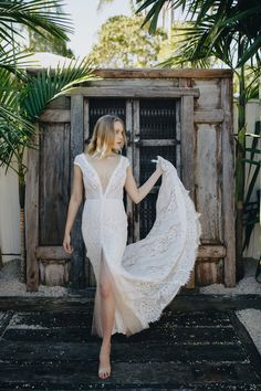 Soft lace and subtle nude underlay, this dress is for the daring bride with her deep V neckline, V Back and revealing split up the front. The semi sheer bodice highlights the skin undertones beautifully.  // Bohemian Brides // Gold Coast Bridal Store // Wedding Dress // Unique Bride //