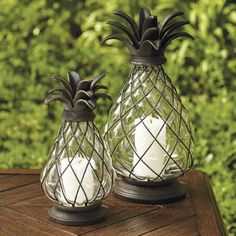 Our Pineapple Hurricane is a welcoming symbol of hospitality. When paired with candlelight, it sheds a soft glow during outdoor evenings. Brass         caging covers the blown-glass orb, finished with an open, leafy pineapple, cast-aluminum top.                             Gold highlights glisten on the bronze, all-weather finish         Blown glass; no two will be exactly alike                   Bottom detaches            for easy candle placement           Wipe clean with a damp sof...